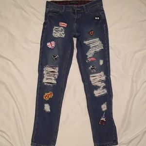 Rue 21 stylishly ripped patch skinny jean